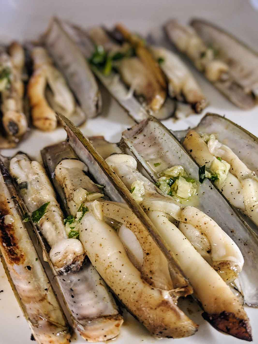 Grilled razor clams with garlic and parsley