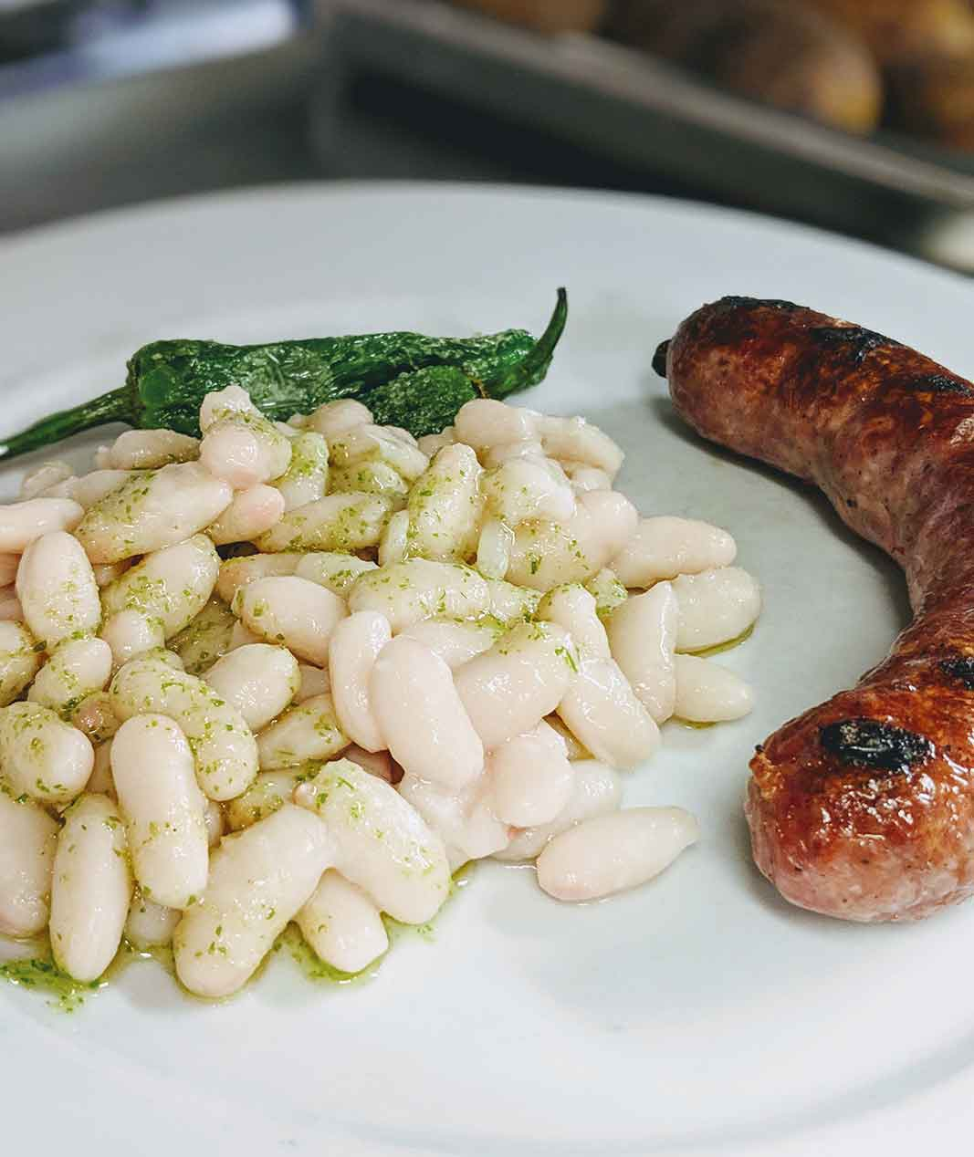 Botifarra (large Catalan pork sausage) with haricot beans